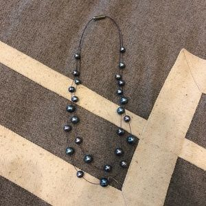 Faux black pearl illusion necklace.